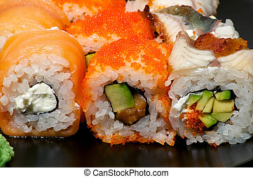 Various sushi on the plate close up