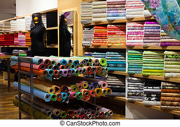 interior of fabric shop - various textiles for sale in...