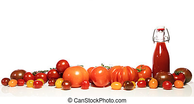 various tomatoes and bottle