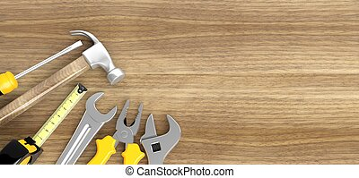 Various tools on wooden background with copy-space