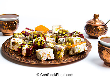 Various Turkish delights on a copper plate isolated