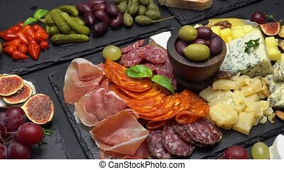 various type of italian meal or snack - cheese, sausage,...