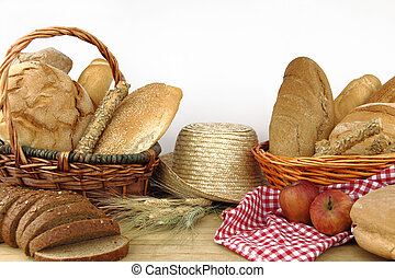 Various types of bread inside of the basket