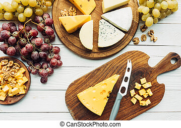 various types of cheese and grapes