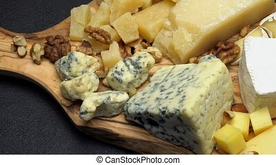 various types of cheese - brie, camembert, roquefort and...