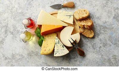 Various types of cheese served on rustic wooden board....
