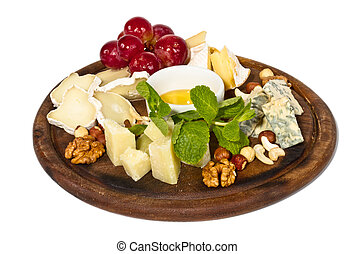Various types of cheese with honey, nuts and grapes on...