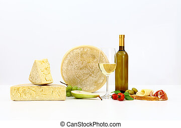 various types of cheese with wine, tomatoes, basil, olives, ...