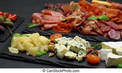 various types of italian food - cheese, sausage and tomatoes...