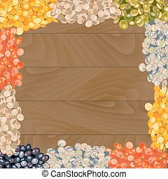 Various types of lentils on wooden background.