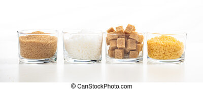 Various types of sugar on white background
