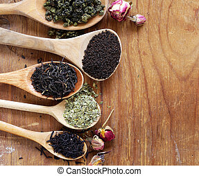 various types of tea in a wooden spoon