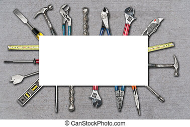 Various used tools on concrete background