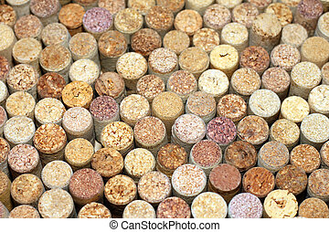 Various used wine corks with traces of wine / selective focus