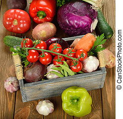 Various vegetables in a wooden box
