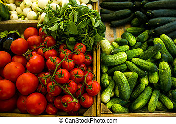 Various vegetables in boxes at market
