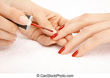Varnish drawing - Process of drawing red varnish on the...