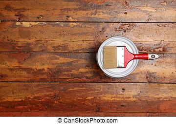 varnishing old wooden plank floor