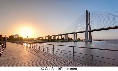 Vasco da Gama bridge during sunset and ebb-tide in Lisbon,...