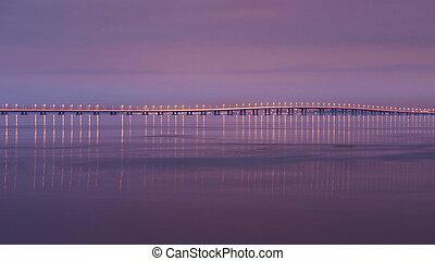 Vasco da Gama suspension bridge at night in Lisbon, Portugal. Long exposure shoot. Famous travel destination