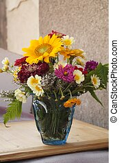 Vase with beautiful colored flowers