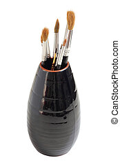 Vase with brushes of the artist