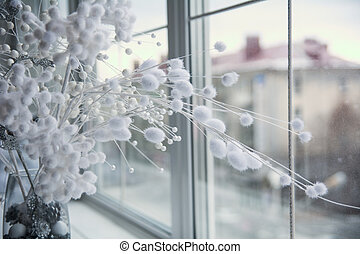 Vase with flower arrangement on the windowsill.