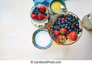vase with fresh berries, product set for breakfast