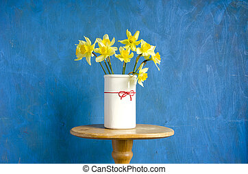 vase with yellow narcissus