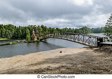 View of the Church of St. Andrew on the island on the lake Vuoksa in Karelia.