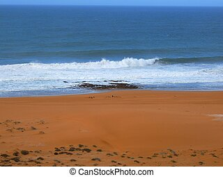 Vast empty beach of the atlantic shores, on a winterday, south of Morocco.