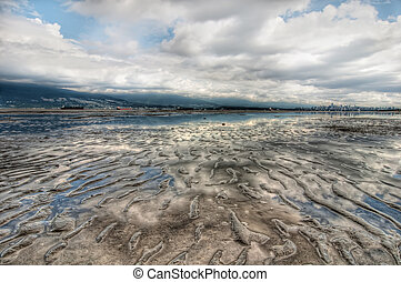 Vast Ripple Beach Landscape With Cloud Reflection and...