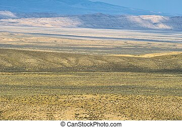 A wide angle view of vast, open and barren wilderness. Great for a background.