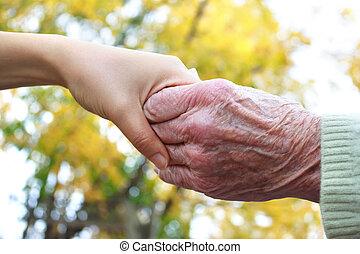 vasthouden, senior, handen, jonge