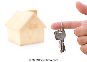 vasthouden, sleutels, voor, een, woning, model, op wit