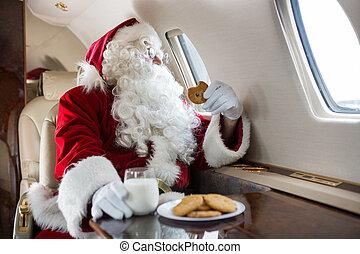 vasthouden, terwijl, particulier, het kijken, venster, door, jet's, kerstman, koekje