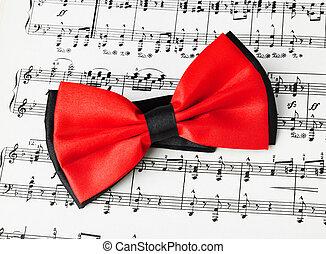vastknopen, het blad van de muziek, rode boog