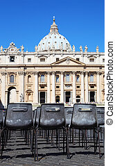 Vatican Museum in Basilica of St. Peter and rows of gray chairs in Rome, Italy