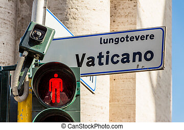 vatican street sign and traffic light with red light.