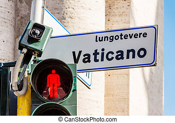 vatican street sign and traffic lights with red light.