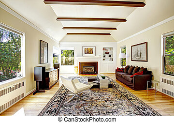 Vaulted ceiling with brown beams in living room - Spacious ...