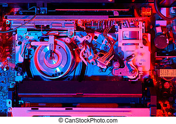 VCR inside illuminated with red and blue colors - Inside of...