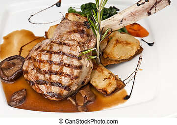 Veal Chop - Broiled center cut veal chop with sauteed onions...