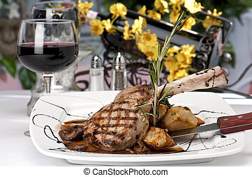 Veal Chop dinner and wine - Broiled center cut veal chop...