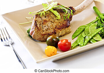 Veal dinner - Gourmet dinner of veal rib chop and vegetables