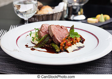 Veal fillet with vegetable ratatouille, parsnip puree,...