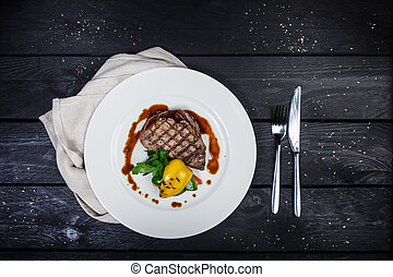 Veal steak with grilled vegetables. Top view.