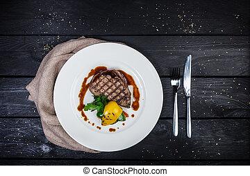 Veal steak with grilled vegetables.