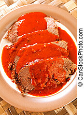 Veal with tomato sauce