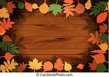 vector autumn leaves on the background wood